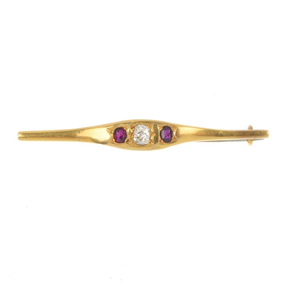 An early 20th century gold diamond and ruby three-stone