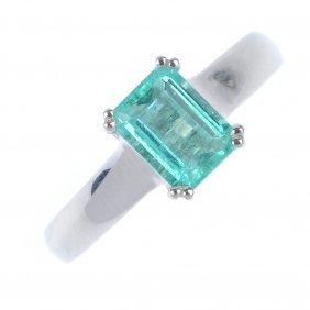 An Emerald Single-stone Ring. The Rectangular-shape