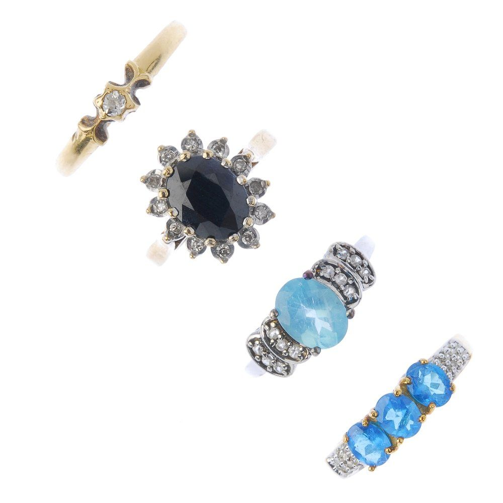 A selection of four gold gem-set rings. To include an