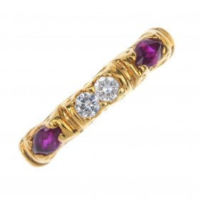 A Diamond And Ruby Band Ring. The Marquise-shape