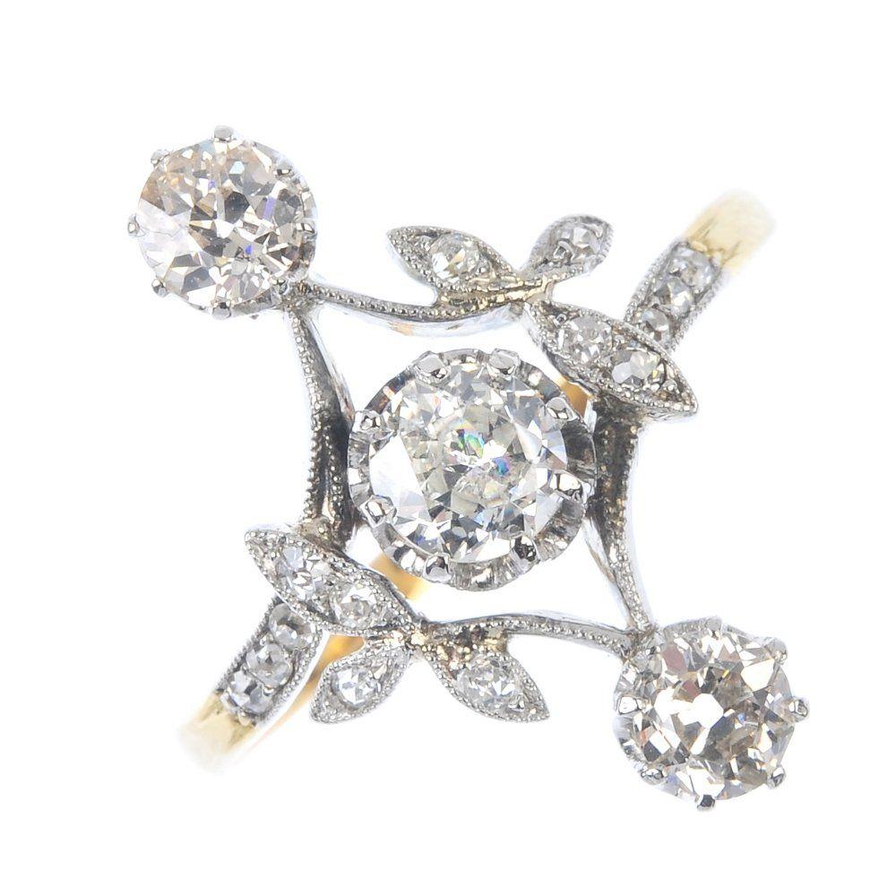 An Edwardian 18ct gold diamond dress ring. Of openwork