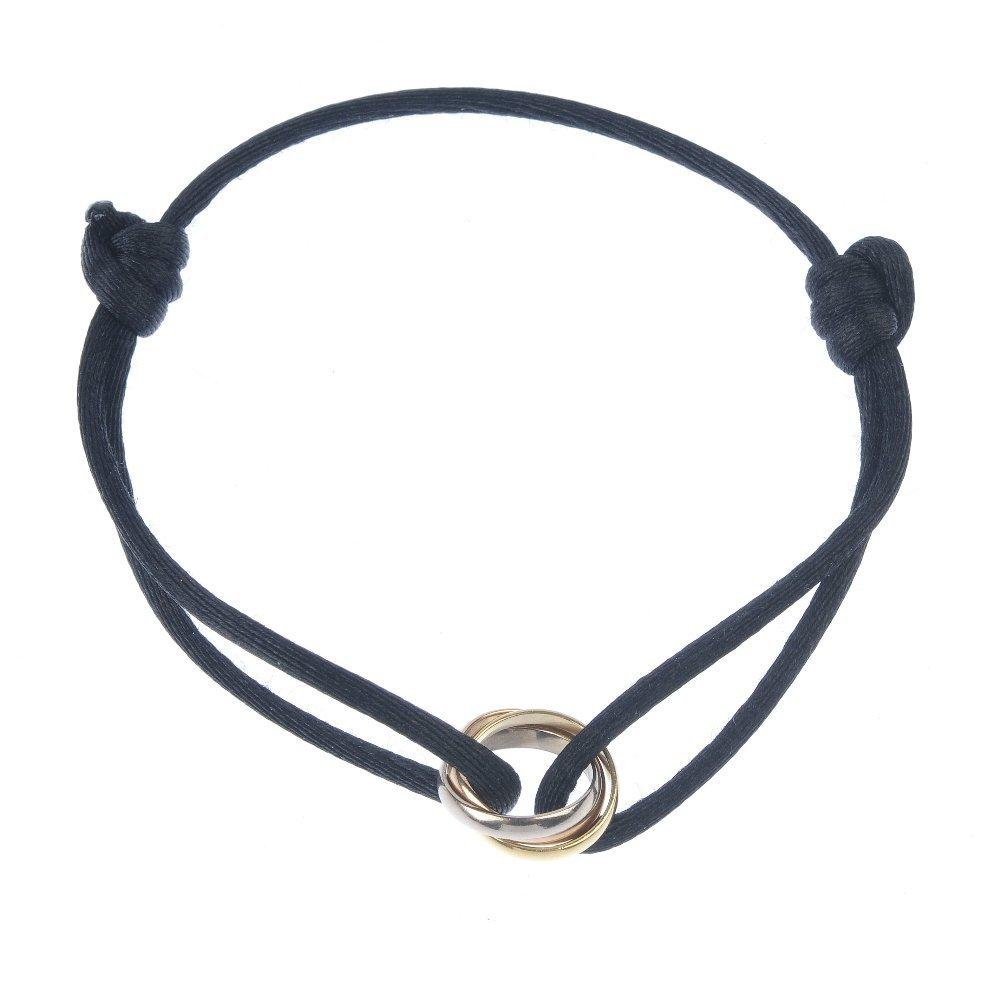 CARTIER - a 'Trinity' bracelet. Of tri-colour design,
