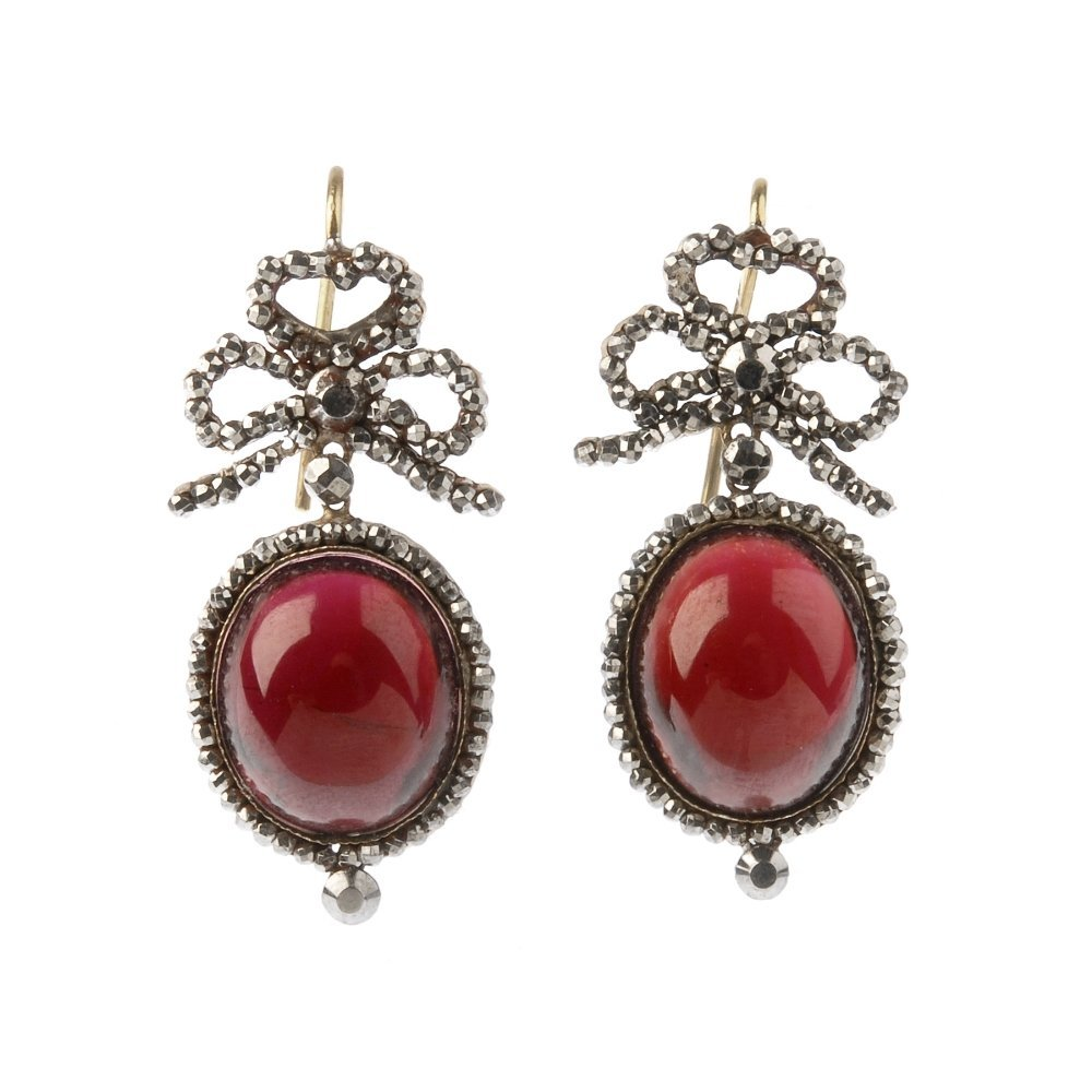 A pair of early Victorian cut steel and red paste ear