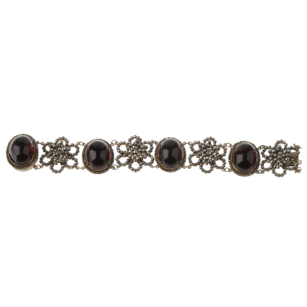 An early Victorian cut steel and red paste bracelet.