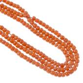 A selection of coral jewellery To include two bead