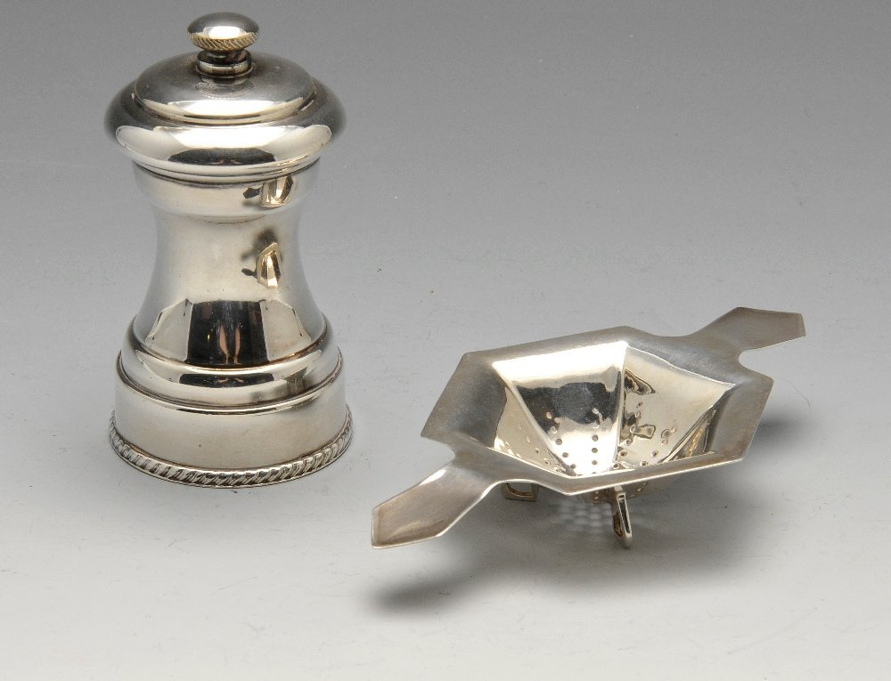 A 1930's silver tea strainer, hexagonal sided with twin