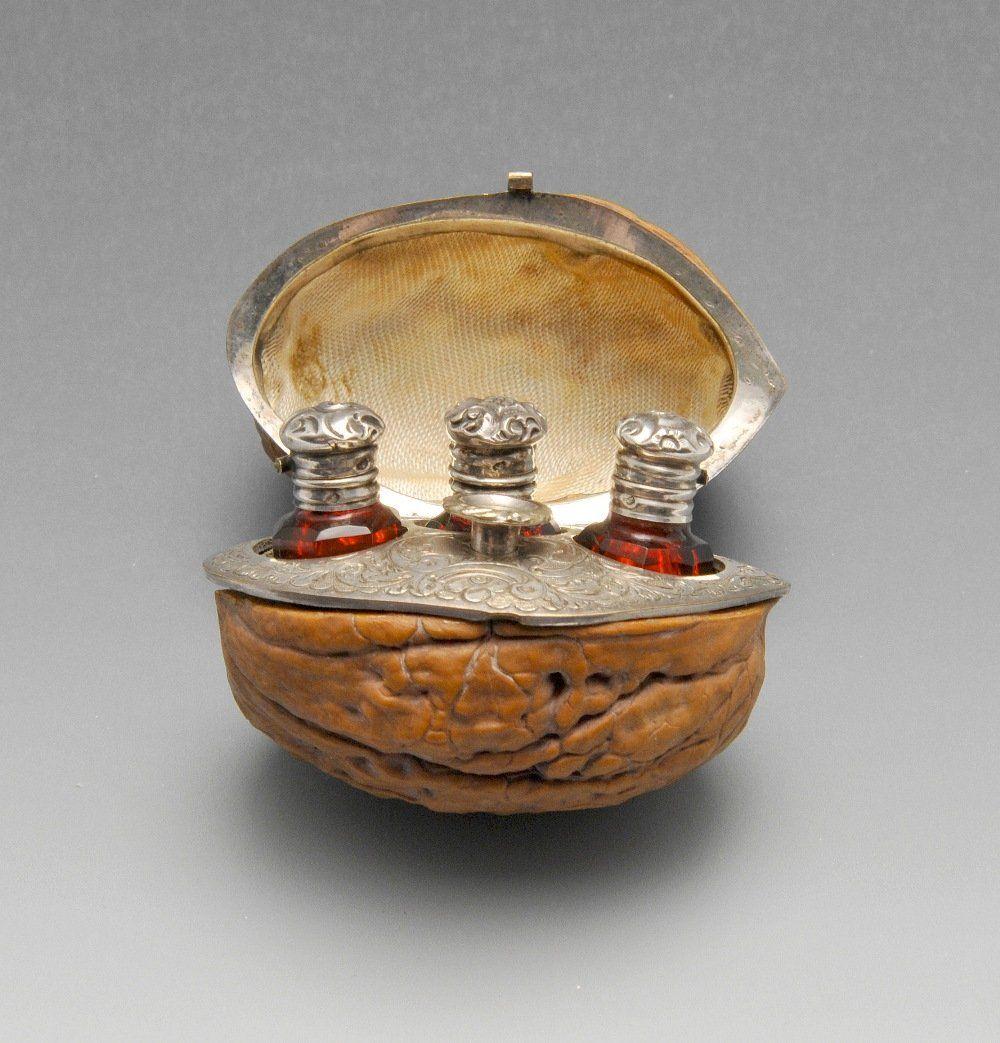 A nineteenth century French hinged walnut case opening