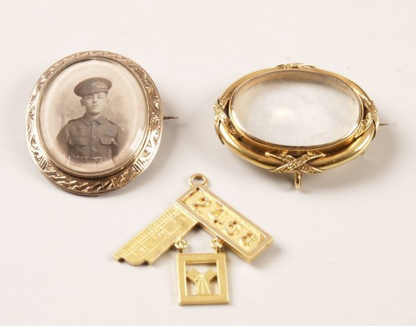 12: 15ct gold Masonic badge, an oval portrait brooch wi