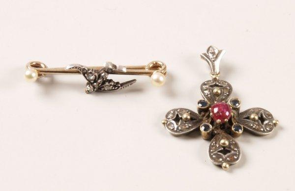 13: Edwardian stock pin with a diamond set swallow to t