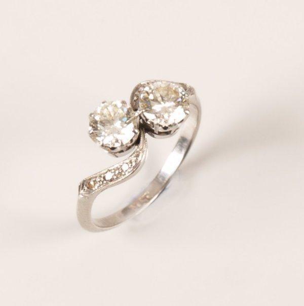 17: Platinum mounted two stone diamond ring, the round