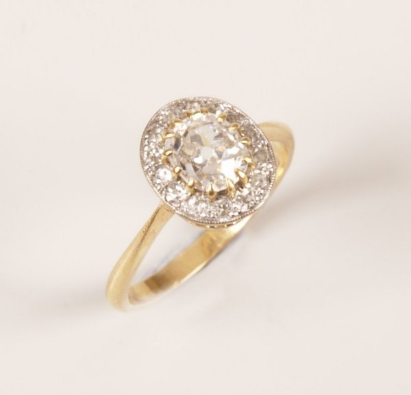 19: 18ct gold diamond cluster ring, a central old mine