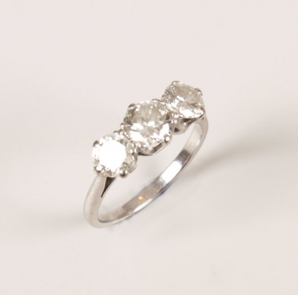 24: Platinum three stone diamond ring set round brillia