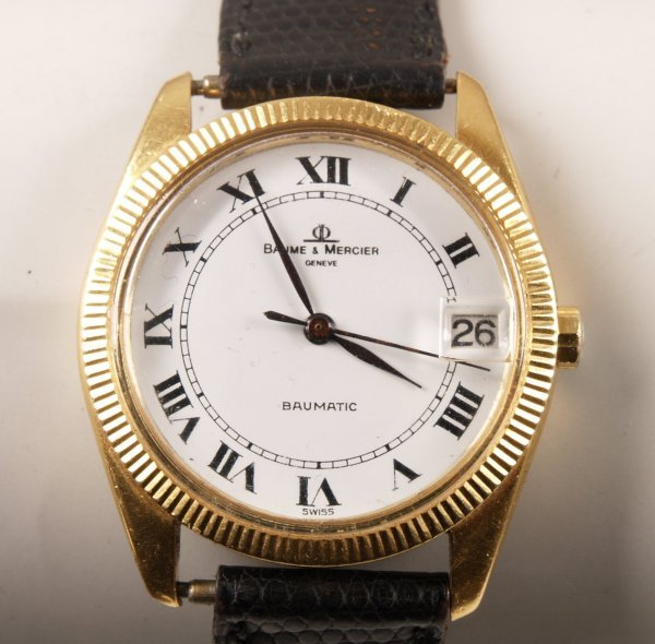 1001: BAUME & MERCIER - a gentleman's 18ct gold 'Baumat