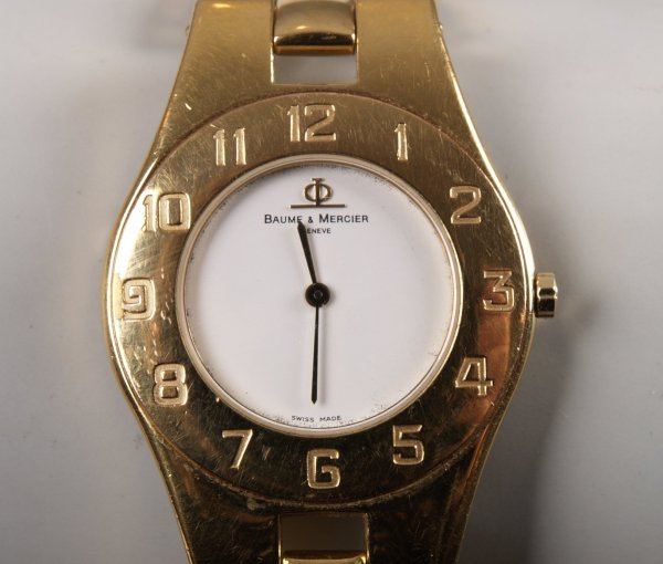 1003: BAUME & MERCIER - a gentleman's gold plated quart