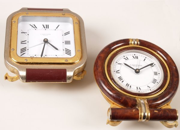 1013: CARTIER  - two battery operated clocks both with