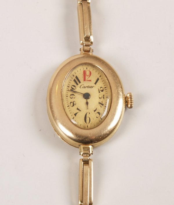 1016: CARTIER - A 1930's ladies 14k gold watch the oval