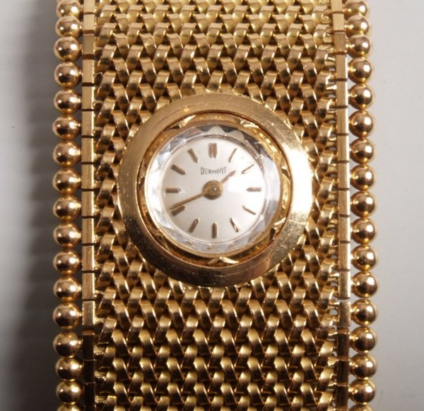 1020: DERMONT - a ladies 18ct gold wide cuff style watc