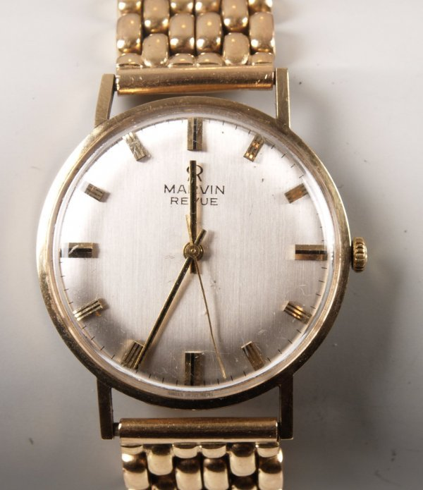 1123: A Marvin Revue gents wrist watch with a gold mult