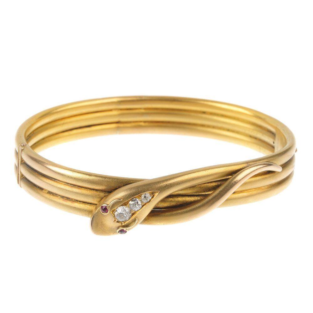 A late Victorian 15ct gold diamond snake hinged bangle.