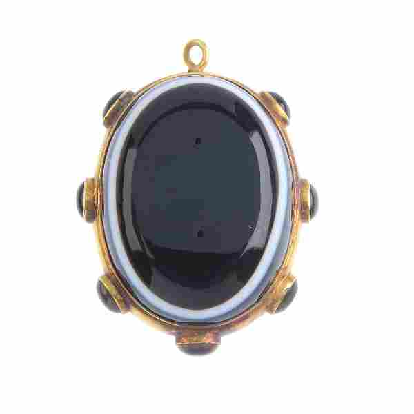 A late Victorian gold banded agate pendant, circa 1880.