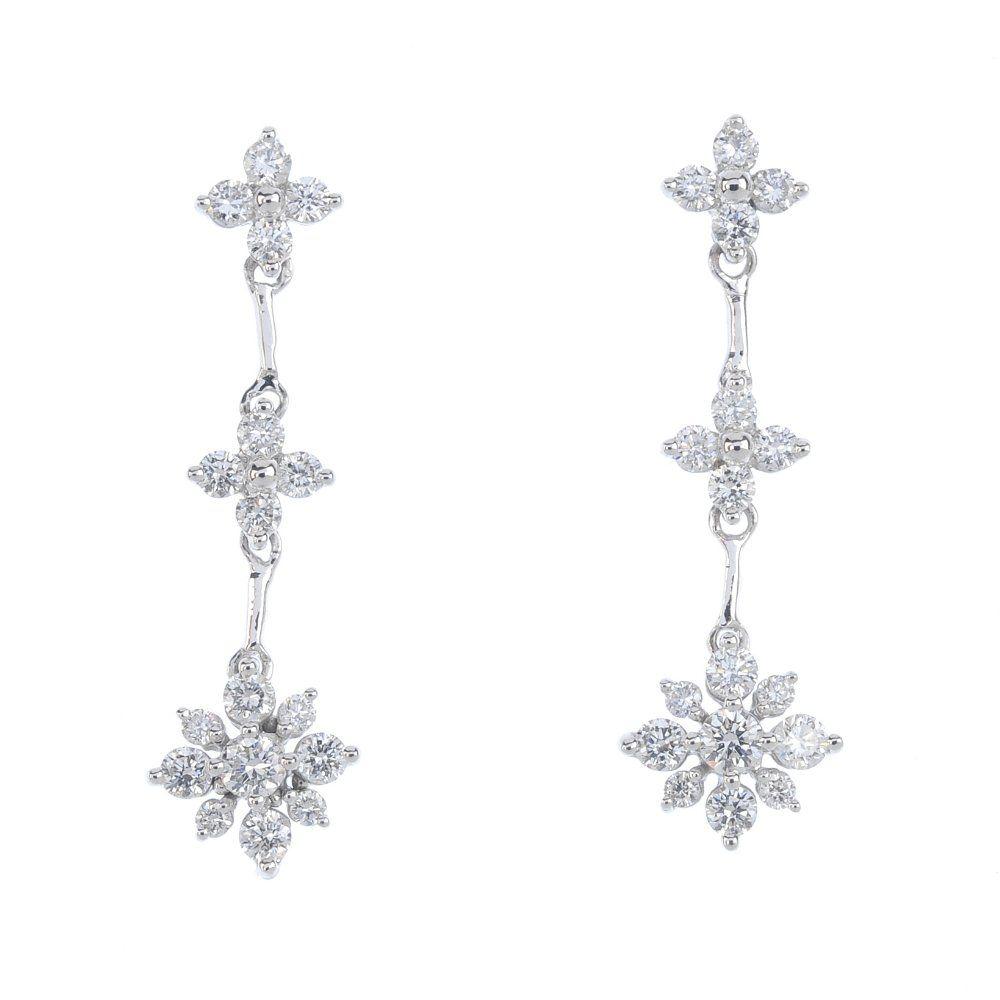 A pair of 18ct gold diamond ear pendants. Each designed