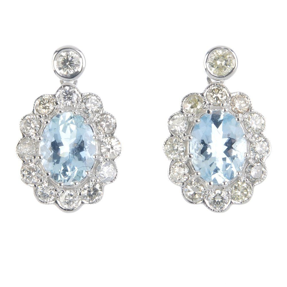 A pair of 18ct gold aquamarine and diamond floral