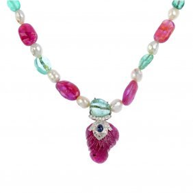 A Natural Pearl, Burmese Ruby And Colombian Emerald
