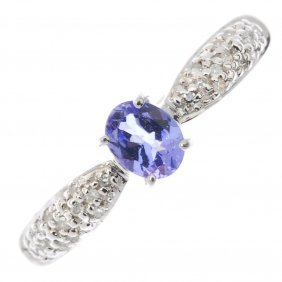 A 9ct Gold Tanzanite Dress Ring. The Oval-shape