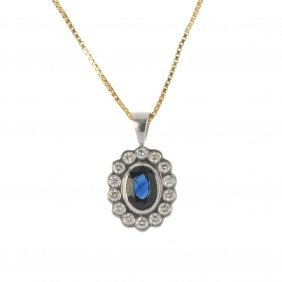 A Sapphire And Diamond Cluster Pendant. The Oval-shape