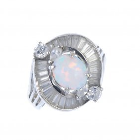 A Synthetic Opal And Cubic Zirconia Ring. The Circular