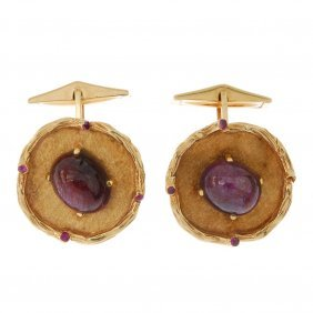 A Pair Of Star Ruby Cufflinks. Each Designed As An Oval