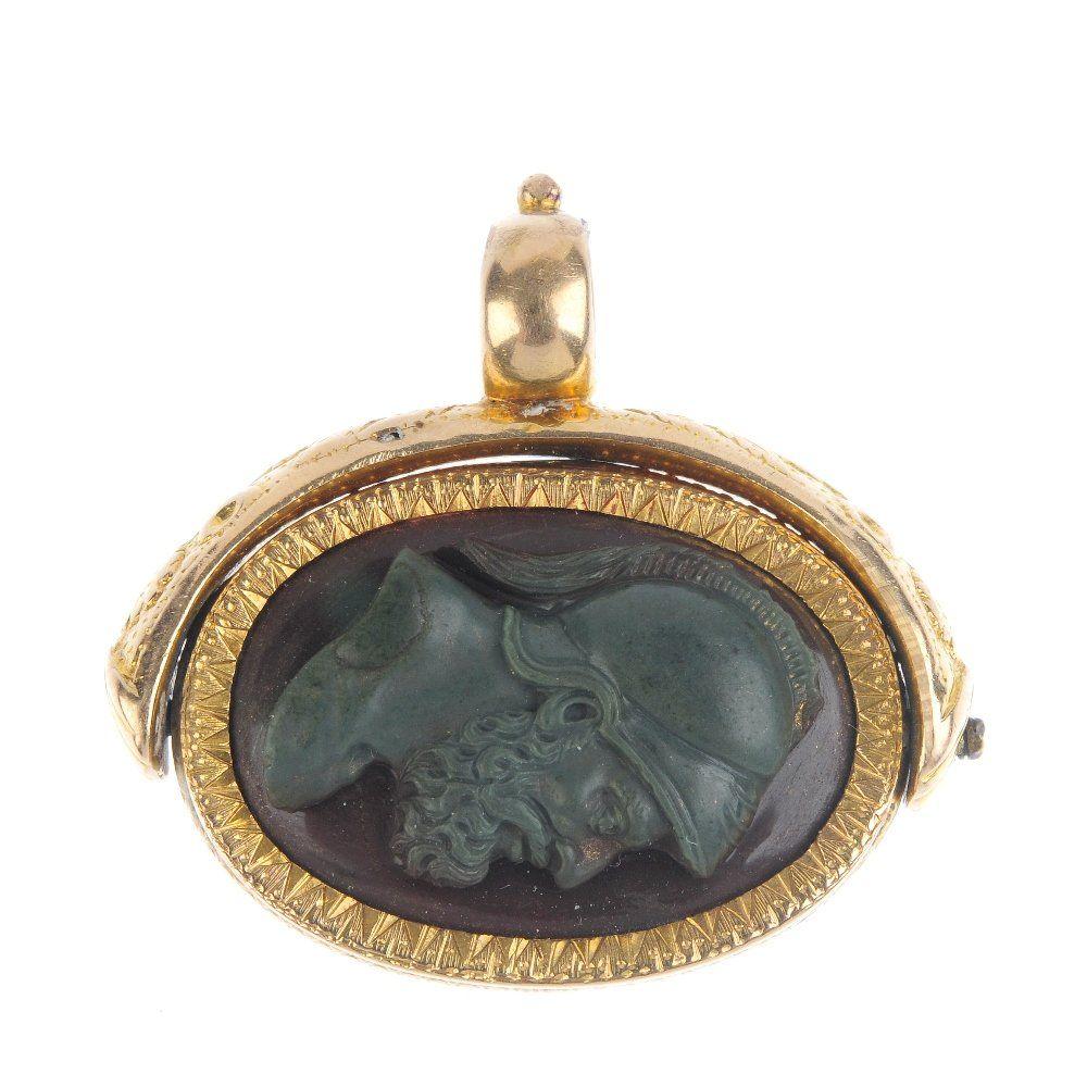 A late Victorian gold hardstone cameo swivel fob, circa