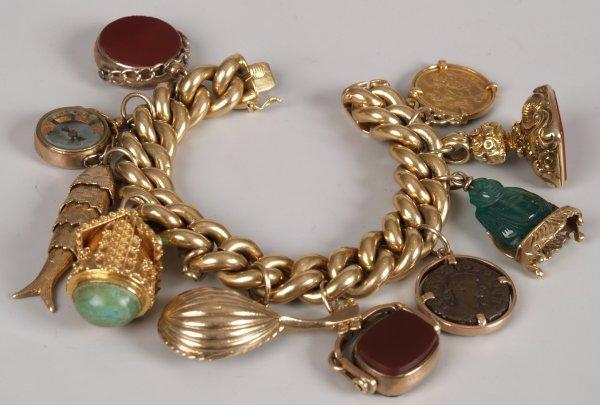 "4: ""18ct gold large curb link bracelet with ten assorte"