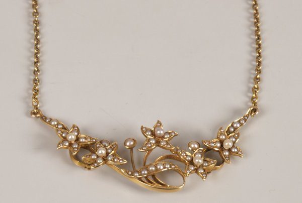 7: Seed pearl set floral design necklet, with a central