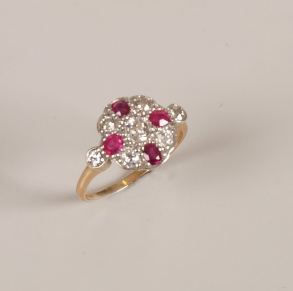 """9: """"18ct gold ruby and diamond set cluster ring, with a"""