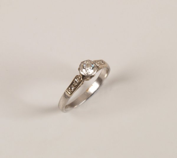 12: Platinum single stone diamond ring with an illusion