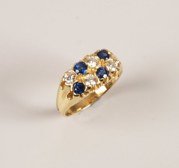 """18: """"18ct gold sapphire and diamond set ring, with two"""