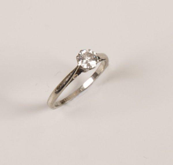 20: Platinum and 18ct white gold single stone round bri