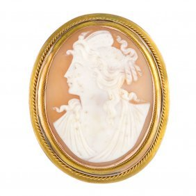 A Cameo Brooch. Of Oval Outline, The Carved Shell