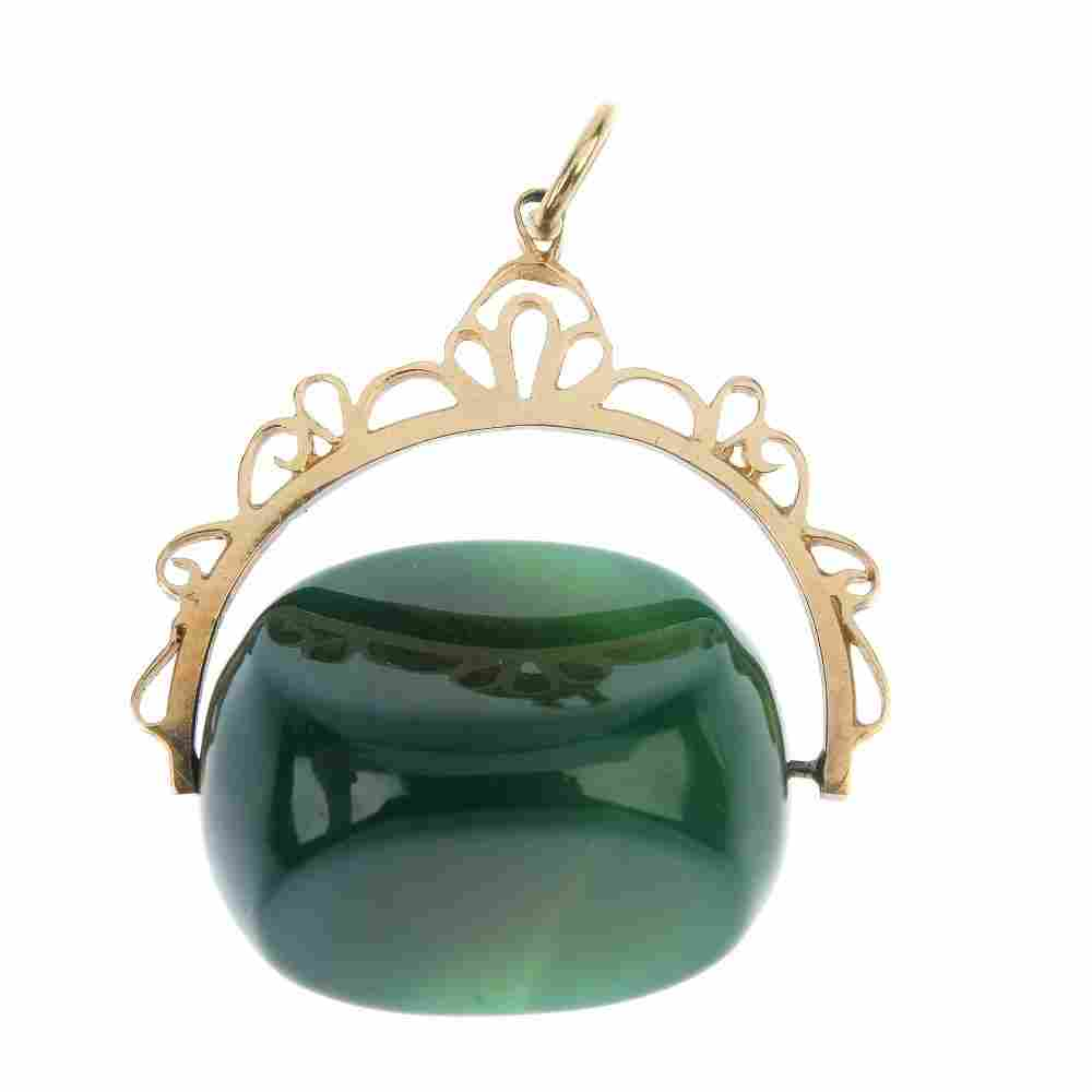 A 9ct gold fob. The swivel fob with green chalcedony