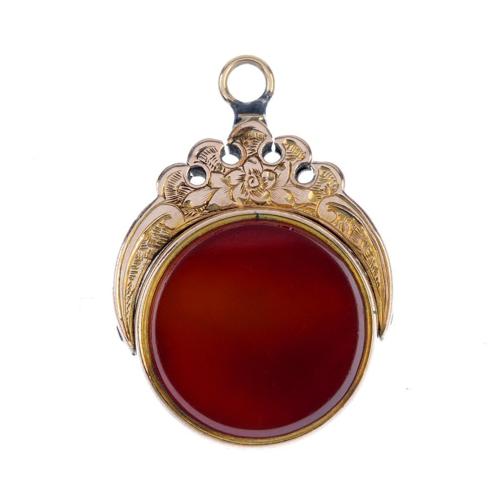 A swivel fob. The circular swivel panel with bloodstone
