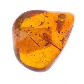 A Natural Dominican Amber Pendant With Inclusions.