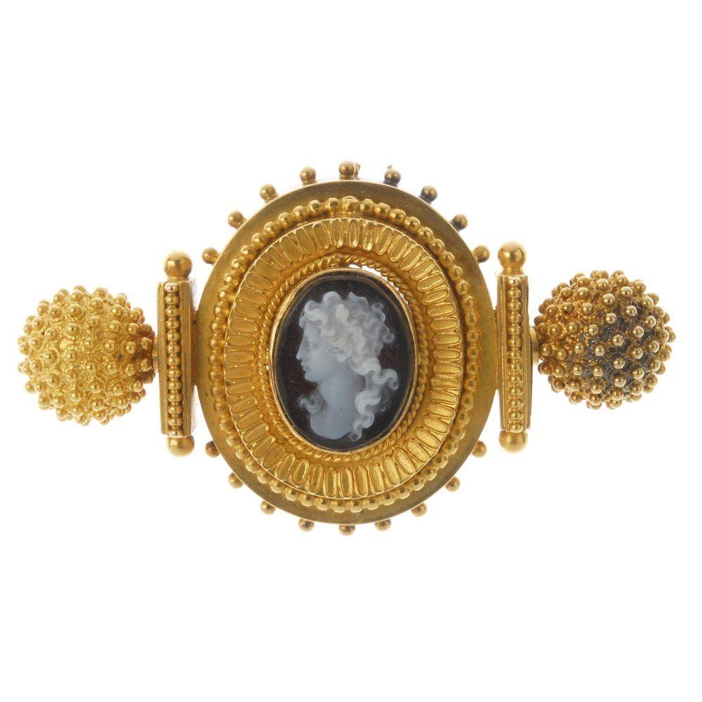 A late Victorian gold hardstone cameo brooch, circa