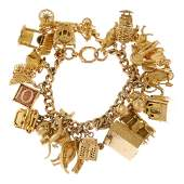 A 9ct gold charm bracelet. The curb-link chain,