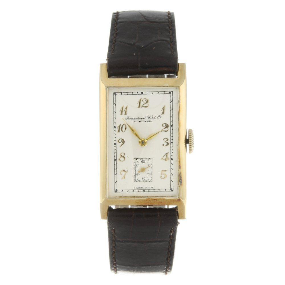 IWC - a gentleman's wrist watch. Yellow metal case,