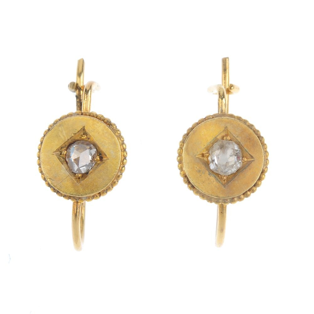 A pair of diamond earrings. The late Victorian gold