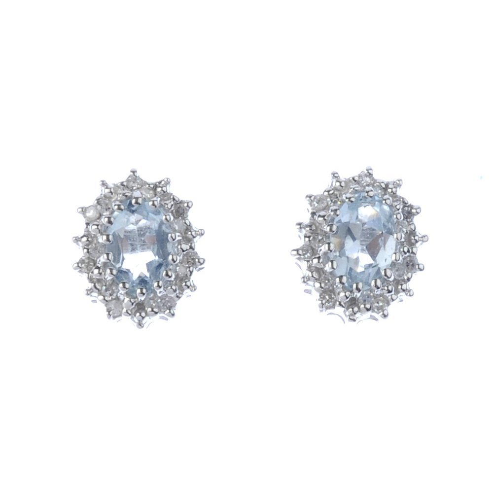 A pair of aquamarine and diamond cluster earrings. Each