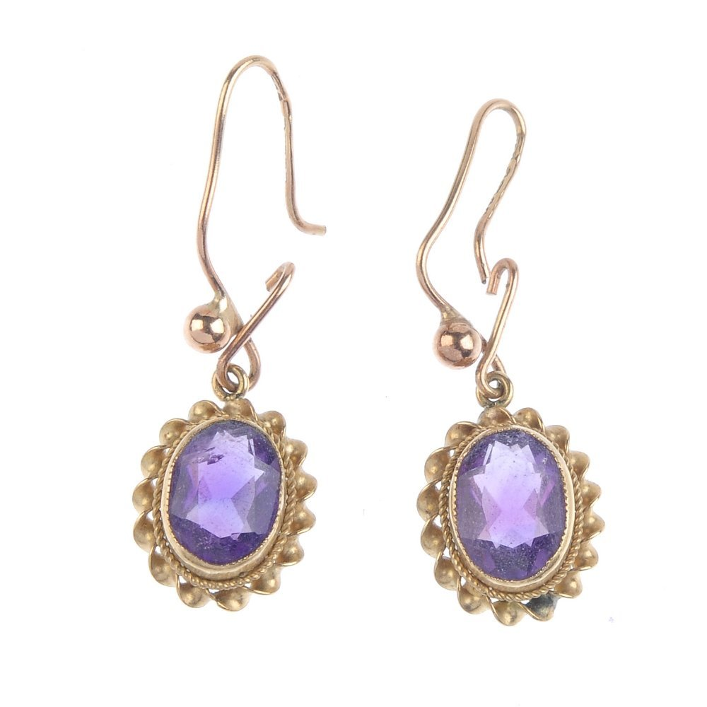 A pair of gold amethyst earrings. Each designed as an