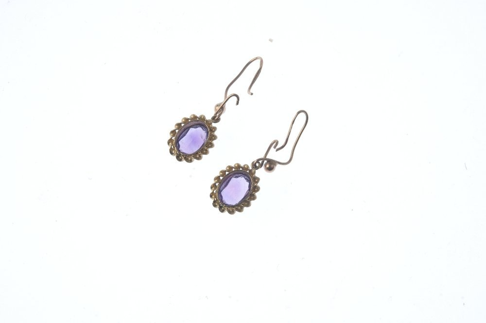 A pair of gold amethyst earrings. Each designed as an - 2
