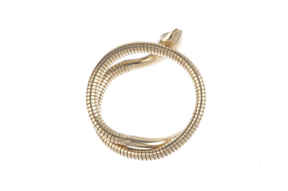 A 9ct gold snake bangle. Designed as an engraved snake - 2